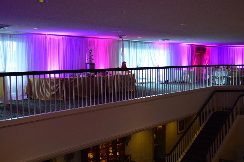 purple hallway at wedding venue