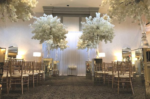 wedding banquet hall in Michigan ceremony set up with flowers